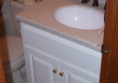 White Vanity with Built-In Toilet Roll Holder