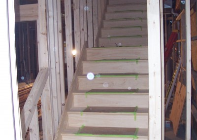 New Construction Staircase in Unfinished Wood 1