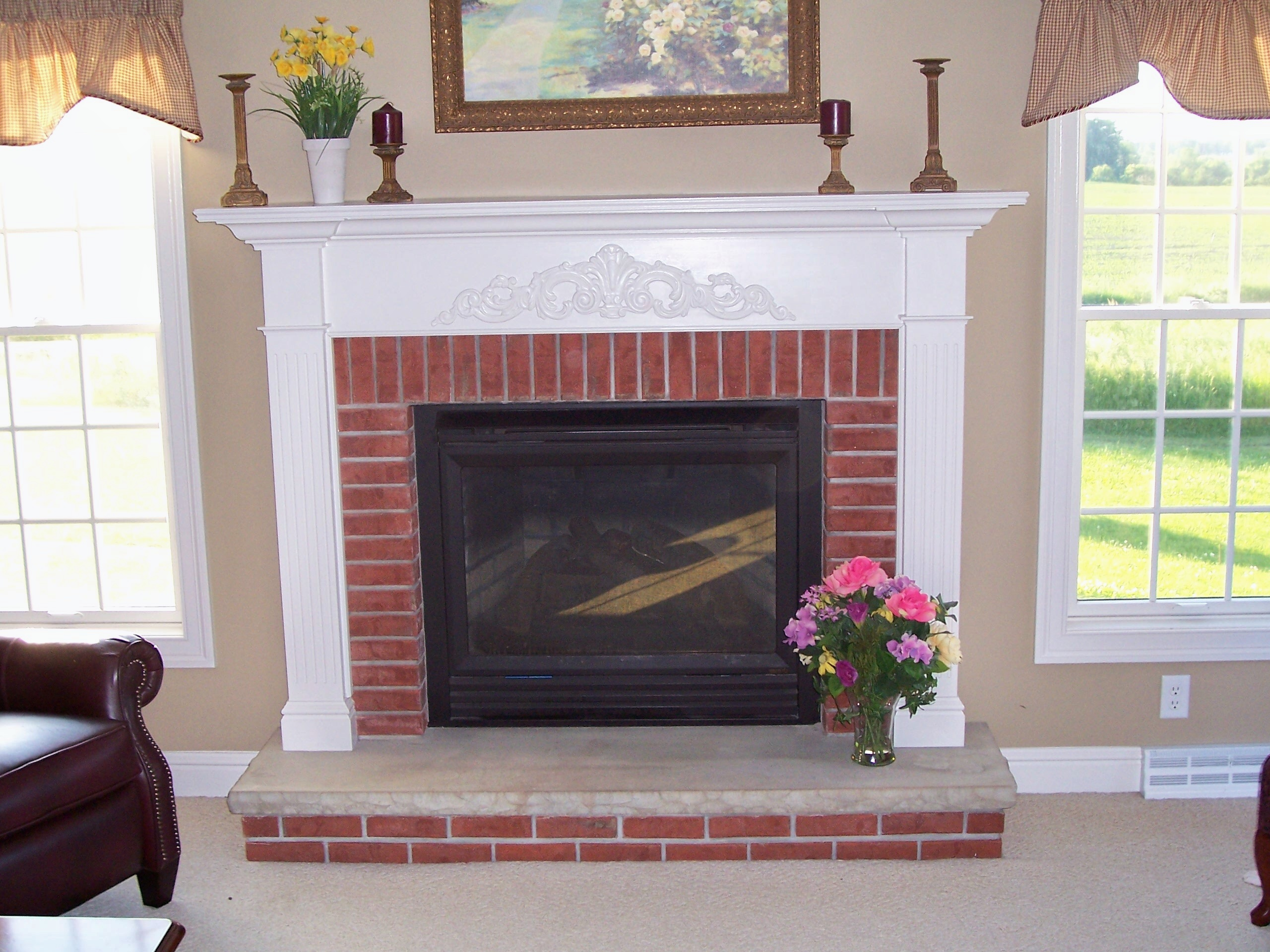 White Mantel And Trim Around Brick Fireplace
